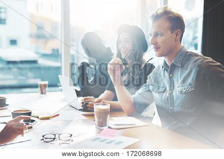 Young People Talking In Cafe Or Office