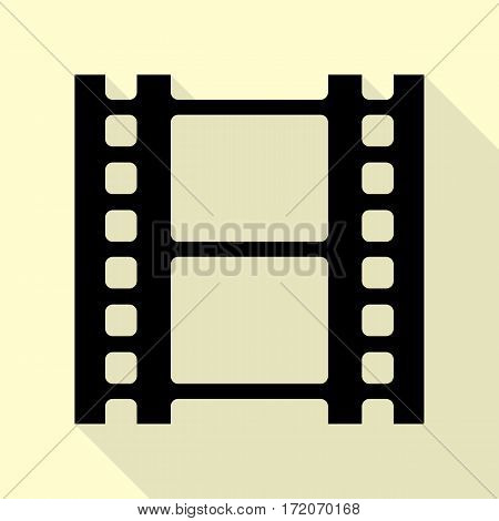 Reel of film sign. Black icon with flat style shadow path on cream background.