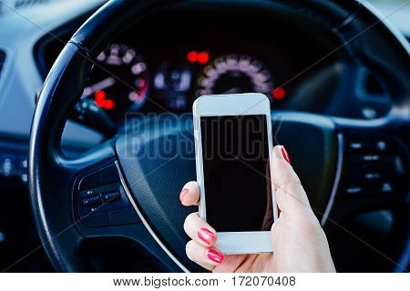 Woman Using White Smartphone In Car