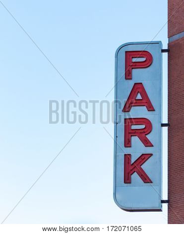 Park Sign on Side of Building with copy space to left