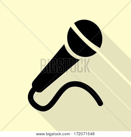Microphone sign illustration. Black icon with flat style shadow path on cream background.