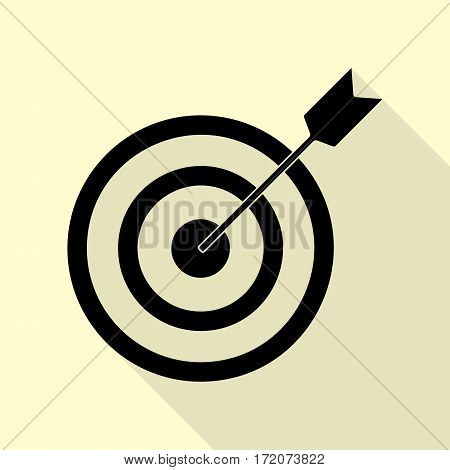 Target with dart. Black icon with flat style shadow path on cream background.