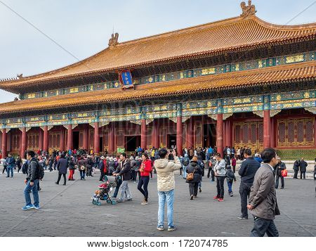 Beijing, China - Oct 30, 2016: The Hall of Supreme Harmony (Taihedian), Forbidden City (Gu Gong, Palace Museum). Visitors abound.
