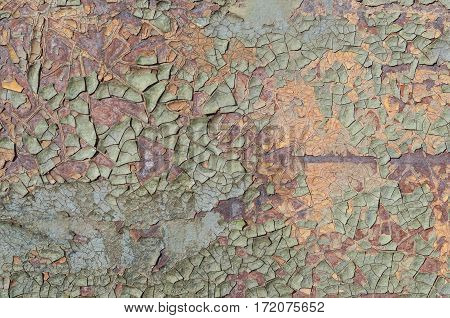Texture of rusty sheet metal with old paint