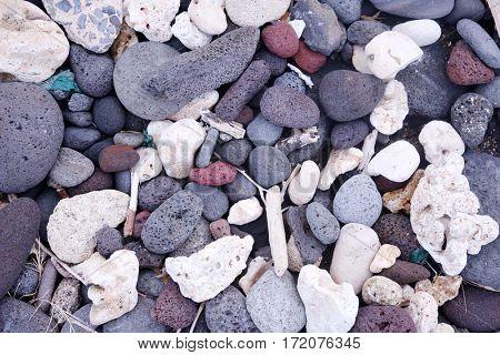 beach. rocky beach on Maui Hawaii. Hawaiian volcanic rock, coral reef, stone, sand and ocean shoreline.