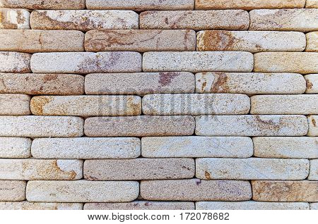 Brick red wall texture background close up