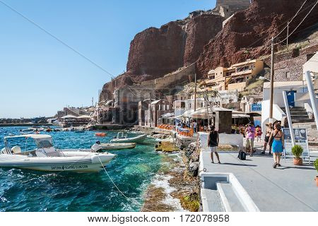 OIA, SANTORINI, GREECE - AUGUST 2015: Small port of Oia town with many tourists on Santorini island, Greece