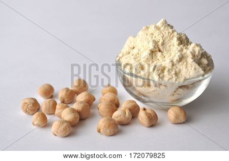 Chickpea flour and chickpeas isolated on white. Alternative gluten-free flour for baking and cooking.