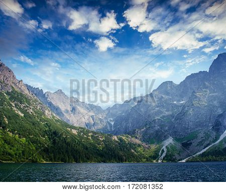 Lake Hallstatt under beautiful white clouds in blue sky