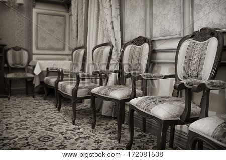 Vintage antique chairs in a classic interior