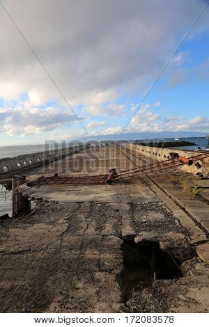 abandoned boat dock. a dangerous abandoned boat dock in disrepair on the island of maui Hawaii