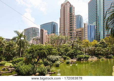 Kowloon Park, Hong Kong, surrounded by high-rise offices and apartments