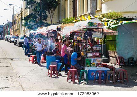 GUATEMALA CITY, GUATEMALA-DEC 25, 2015: Mayans sell  Guatemalan food  at the street  of Guatemala city on Dec 25 2015. Guatemala.