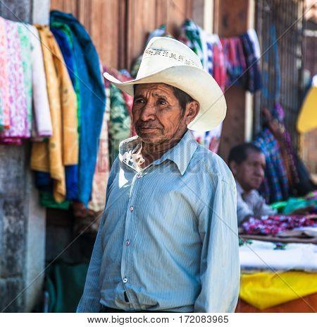SAN PEDRO, GUATEMALA-DEC 24, 2015: Local mayan people at main street  in San Pedro on Dec 24, 2015, Guatemala.
