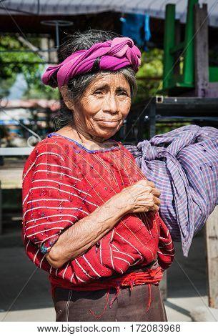 PANAJACHEL, GUATEMALA-DEC 24, 2015: : Guatamalian woman carries her bag  in Panajachel on Dec 24, 2015, Guatemala.