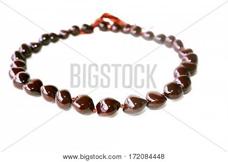Kukui nut lei. hawaiian kukui nut necklace or lei isolated on white with room for your text.