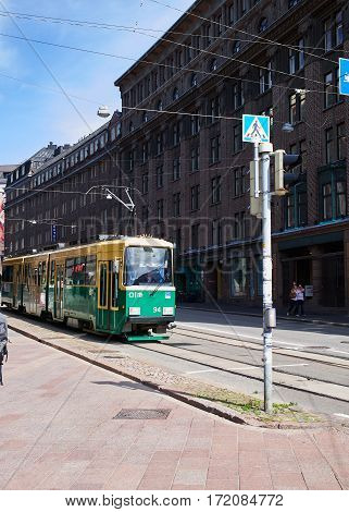 HELSINKI, FINLAND - JULY 17, 2015: The movement of the tram on streets of Helsinki.