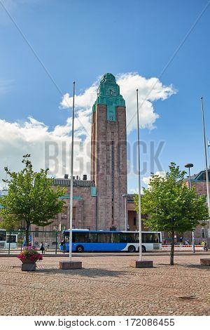 HELSINKI, FINLAND - JULY 17, 2015: Scenic summer panorama of the railway station square in Helsinki.