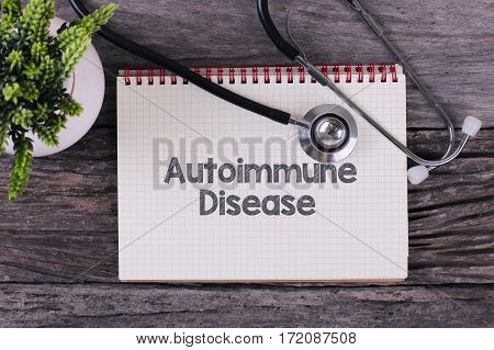 Autoimmune Disease Word On Notebook,stethoscope And Green Plan.