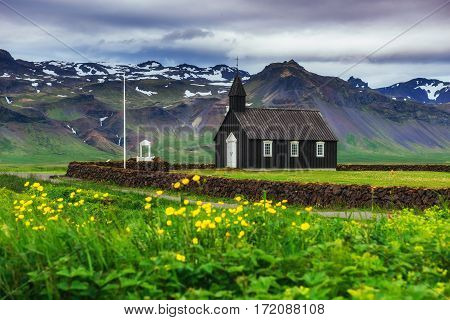 Mountain View Iceland. Beautiful black wooden church in Budir