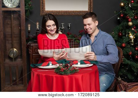 Couple explore the menu at luxury restaurant