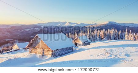 Fantastic winter landscape, the steps that lead to the cabin. Magic event in frosty day. In anticipation of the holiday. Dramatic scenes. Carpathian, Ukraine, Europe.
