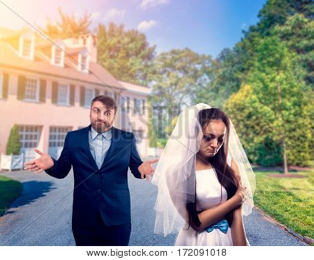 Tearful bride and puzzled groom, unhappy marriage