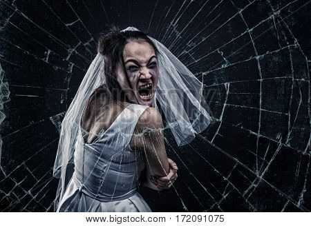 Screaming bride against cracked glass