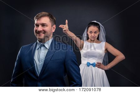 Sly bride brought a finger gun at her groom