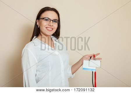 Female office worker shows badges