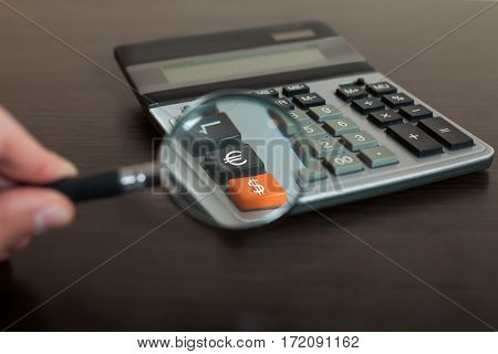 Looking through magnifying glass on calculator