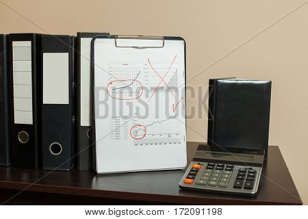 Accountant ñhancellery on wooden table closeup