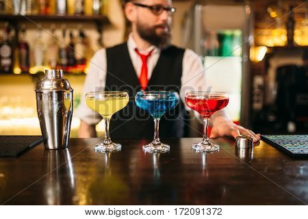 Bartender behind bar counter show alcohol coctails