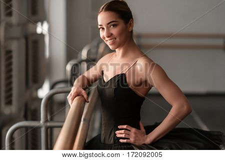 Female ballet dancer hold on to the barre