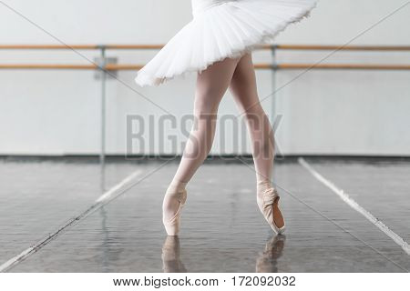 Female ballet dancer keep the rack