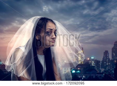 Tearful bride on the background of night city