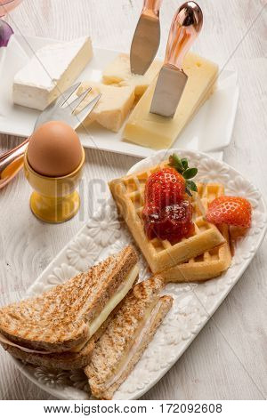 mixed brunch with  eggs french toast cheese and waffle