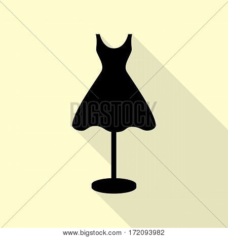 Mannequin with dress sign. Black icon with flat style shadow path on cream background.