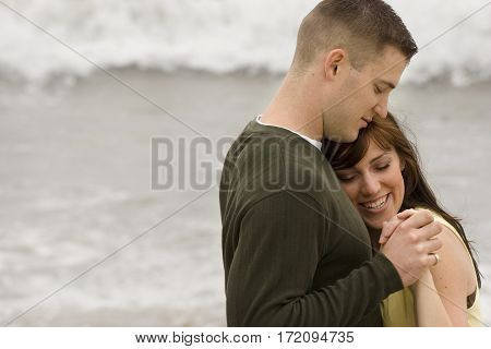 Beautiful couple share romantic moments on the beach.