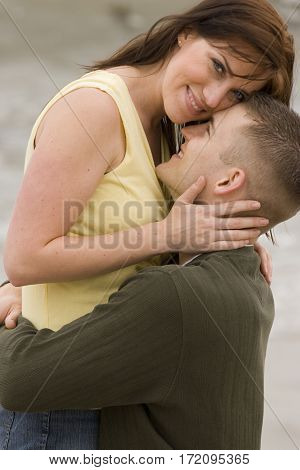 Beautiful couple share romantic moment on the beach.