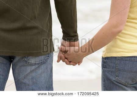 Young couple share romantic moment on the beach.