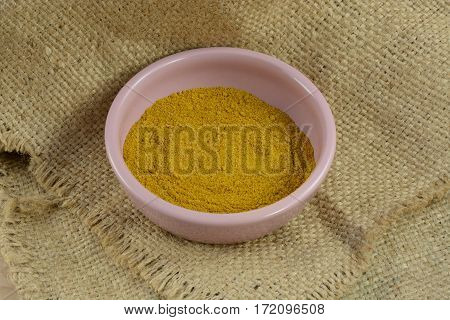 Bowl of ground Madras hot curry spice in bowl