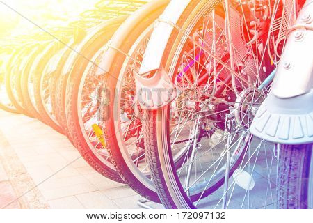 Wheel detail of a group of bikes with color filters