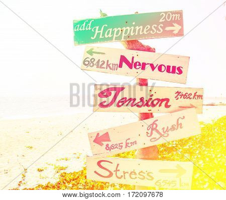 Wooden signboard on the beach with color filters