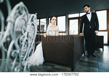 Beautiful wedding photo, bride and bridegroom at big window background