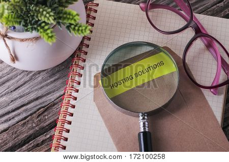 Business Concept : Hosting Solution Written On Envelope With Wooden Background.