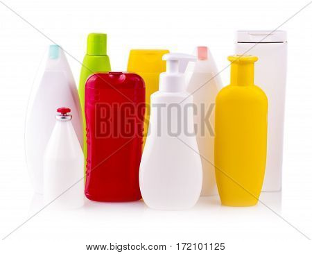 close up of a white and colored bottles on white background