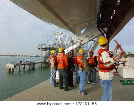 GALVESTON, TX- Prospective offshore workers practice launching lifeboats, January 19 2012