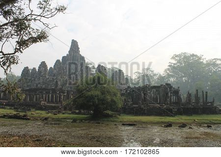 The morning mist over ancient temple in a tropical jungle