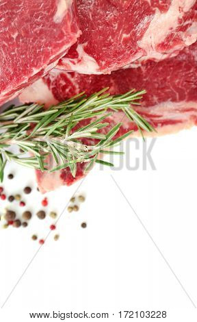 Raw steak with spices on white background